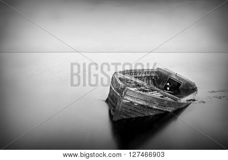 Old Boat Abandoned In Water