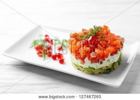 Delicious salmon tartare on white plate