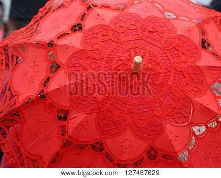 red umbrella all hand-decorated with lace doilies
