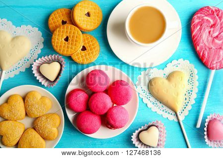 Valentine concept. Composition of cookies and candies on blue background