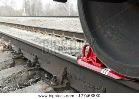 brake wheel on railway of train. Train shoe propped wheel train.