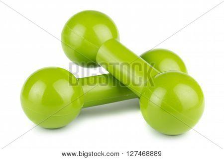 Two green plastic dumbbells for fitness on white background