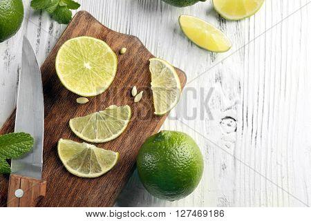 Fresh limes on cutting board