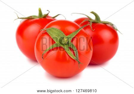 Three ripe red tomatoes on white background