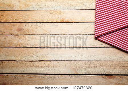 Checkered napkin on wooden background