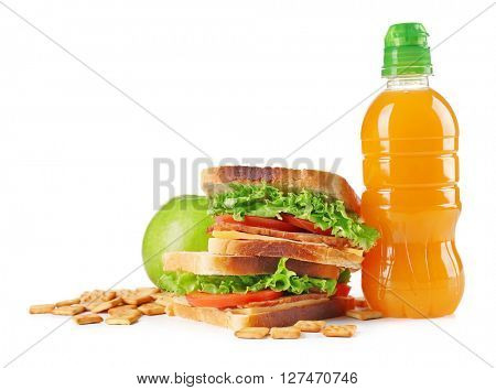 Healthy school lunch with sandwich, fruits and juice isolated on white