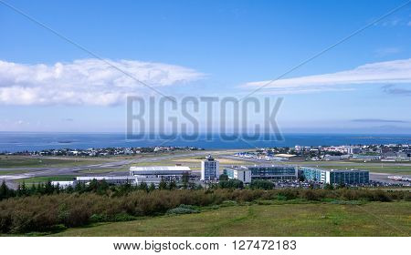 REYKJAVIK ICELAND - JUNE 27: Panorama of domestic Reykjavik airport and hotels nearby during summer on June 27, 2014.