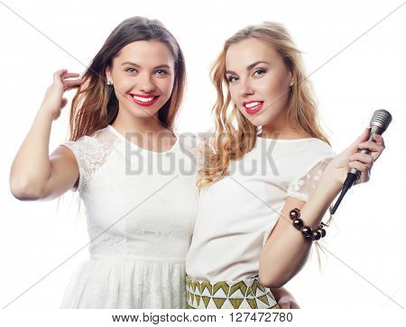 two young girls singing