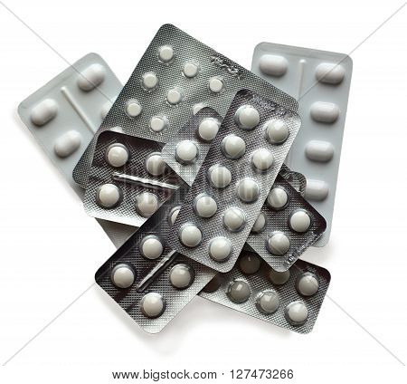 different white pills isolated on white background