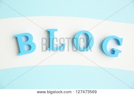 Word BLOG from blue letters on striped background