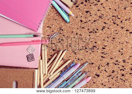 Stationery on cork desk background