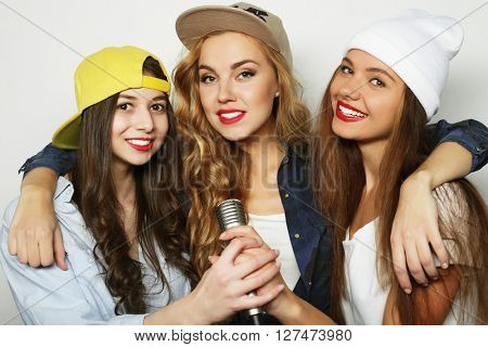 group of young women having fun at karaoke