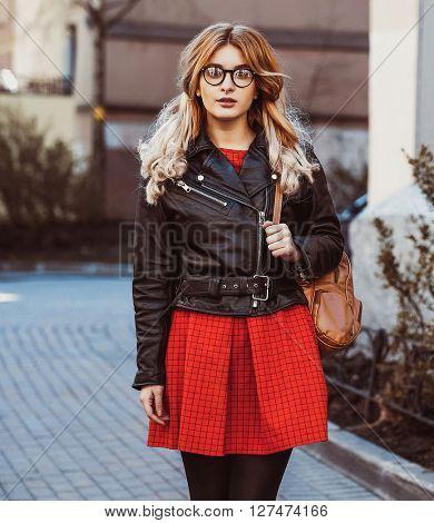 young beautiful blonde woman posing outdoor