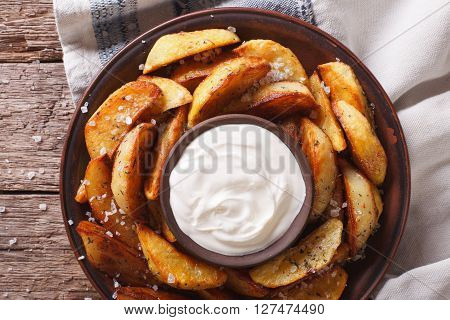 Tasty Potato Wedges With Mayonnaise On A Plate Closeup. Horizontal Top View