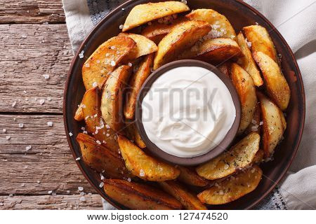 Spicy Potato Wedges With Herbs On A Plate Closeup. Horizontal Top View