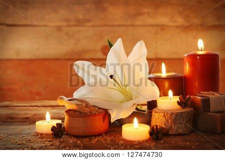 Spa treatment. Sea salt and candles on wooden background.