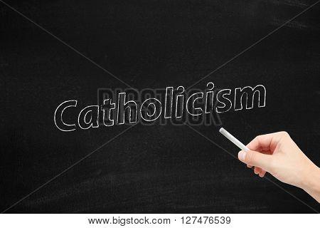 Catholicism written on a blackboard