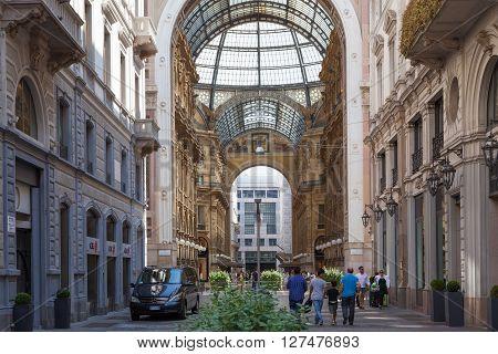Milan, Italy - Circa August 2013: People walking near Galleria Vittorio Emanuele II in Milan.