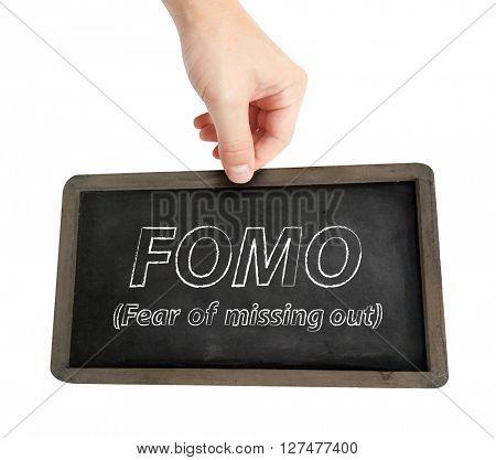 Fomo written on a blackboard