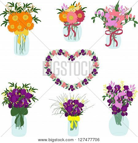Bouquets of iris, freesia, dahlias, tulips, herbera, lily in jars with bows
