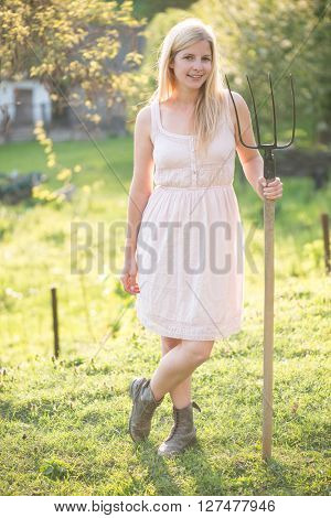 Young woman with pitchfork