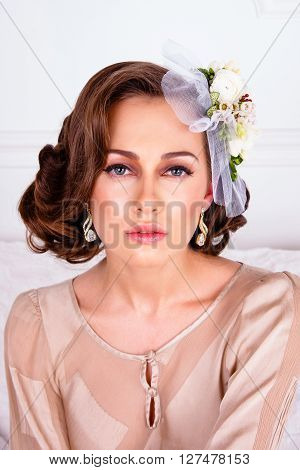 Portrait of pretty woman wearing elegant trendy fashion clothes and flowers on hair