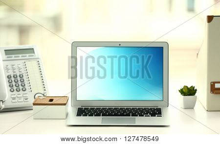 Workplace with laptop on the table