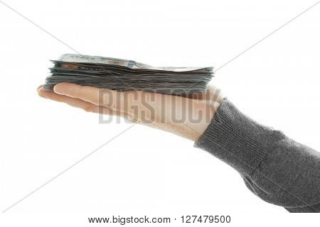 Male hand with money isolated on white