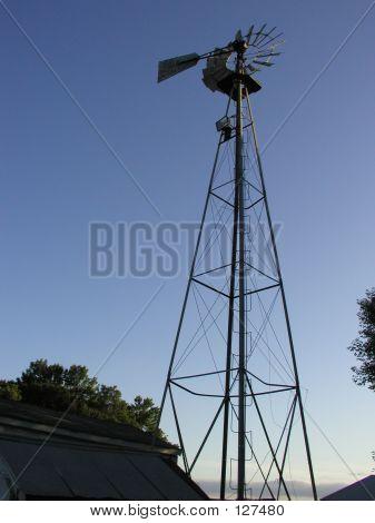 Old Windmill On A Farm