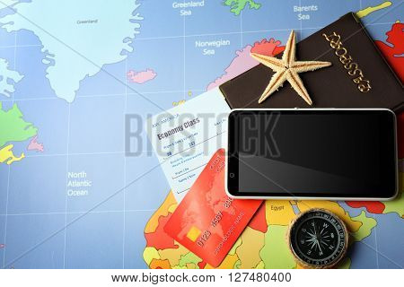Credit cards with passports and tickets for vacations on the world map background