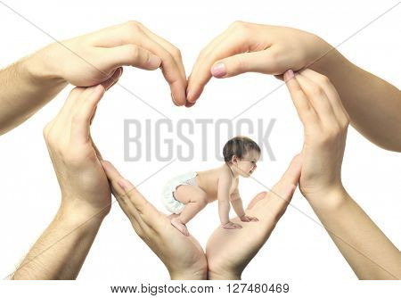 Cute baby girl crawling in heart-shaped hands isolated on white