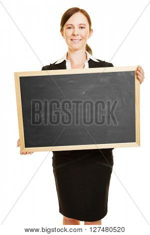 Smiling business woman holding empty black chalkboard in her hands