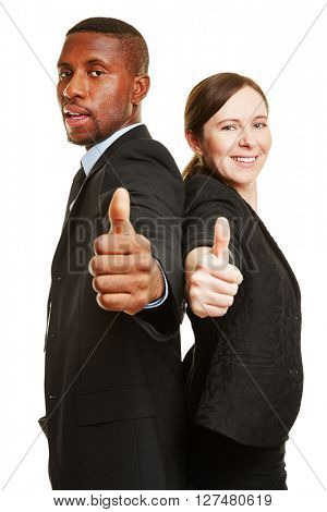Two happy businesspeople holding their thumbs up