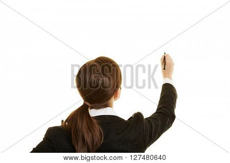 Back view of business woman writing with a pen