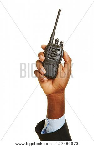 Hand of african man holding up a radio set