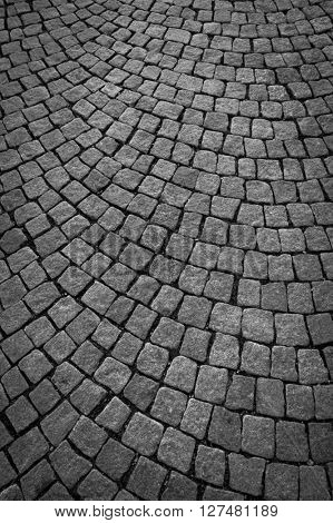 Dark paving stone roadway