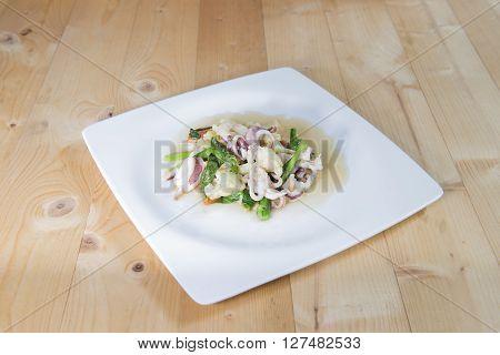 Stir vegetables with squid Thai style food.