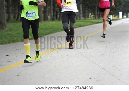 Three people running Cross country Marathon Blured Motion