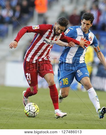 BARCELONA - APRIL, 9: Yannick Ferreira Carrasco(L) of Atletico Madrid and Javi Lopez(R) of RCD Espanyol during a Spanish League match at the Power8 stadium on April 9, 2016 in Barcelona, Spain
