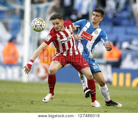 BARCELONA - APRIL, 9: Saul Niguez(L) of Atletico Madrid and Gerard Moreno(R) of RCD Espanyol during a Spanish League match at the Power8 stadium on April 9, 2016 in Barcelona, Spain