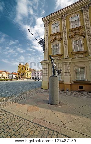 TIMISOARA ROMANIA - MARCH 20 2016: Intersection of streets with old buildings german dome modernist statue and cobblestone paving in the historic center of Timisoara Romania. Fish-eye view.