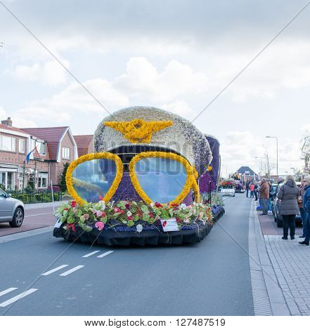 HILLEGOM, THE NETHERLANDS - APRIL 23, 2016: Moving platform with a frame made in a form of pilot sunglasses and cap. Taking part in the  traditional flowers parade