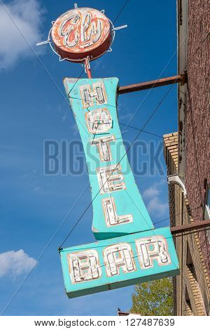 East Ely, Nevada,USA. 11th May 2015 Old neon bar and hotel sign