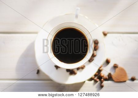 Morning coffee on a white background coffee beans scattered love and good memories.