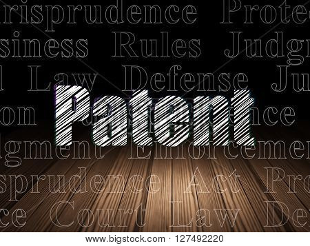Law concept: Glowing text Patent in grunge dark room with Wooden Floor, black background with  Tag Cloud