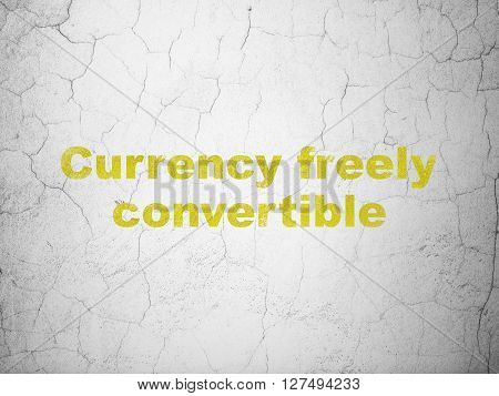 Money concept: Yellow Currency freely Convertible on textured concrete wall background
