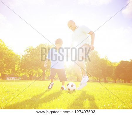 Little Boy Father Playing Soccer Concept