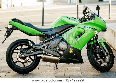 MULHOUSE FRANCE - DEC 19 2015: Beautiful green Kawasaki Moto Pulsion motorcycle on the street of Mulhouse