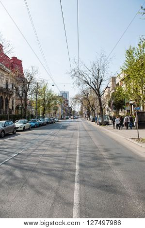 BUCHAREST ROMANIA - APR 2 2016: Dacia boulevard with its beautiful houses and Sheraton hotel in the background in the center of Bucharest Romania