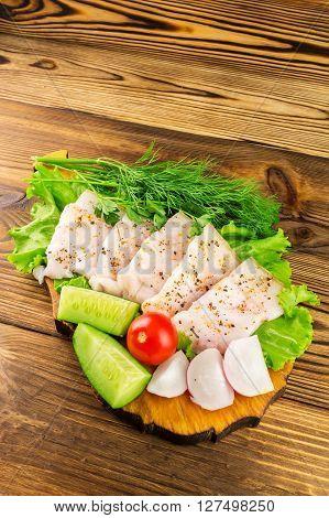 Sliced fresh pork lard fresh produce vegetables on the wooden board.